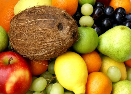 Closeup of coco nut and different fresh tasty fruits Stockfoto