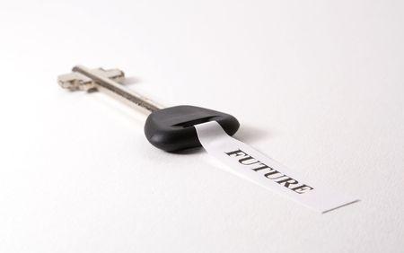 Key to sucess isolated on white background photo