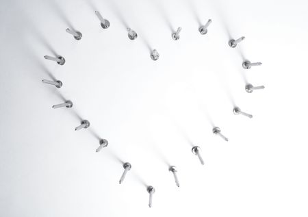 Heart set made of steel nails on white background              photo