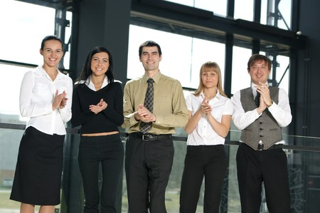 businesspersons: A group of five young businesspersons on a modern office background