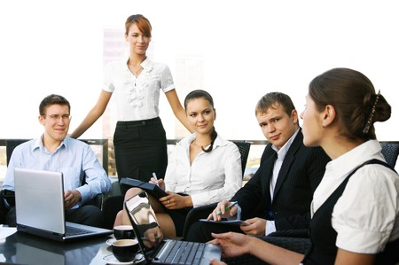 Five young businesspersons are having a meeting photo