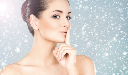 face lift: Spa portrait of young and beautiful woman over winter Christmas background