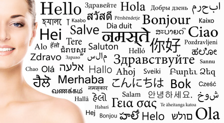 Portrait of a woman over the background with a different world languages (language school concept)