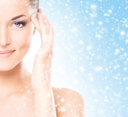 winter celebration: Spa portrait of young and beautiful woman over winter Christmas background