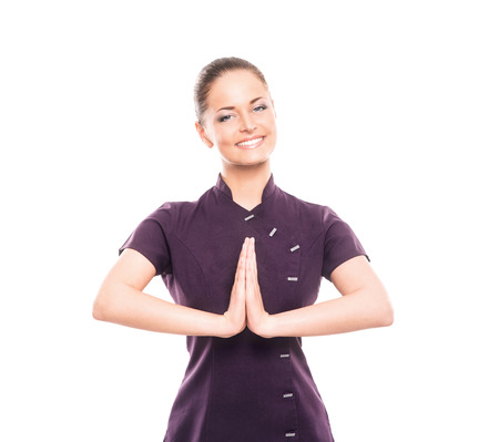 massagist: Young, happy and attractive girl in a uniform isolated on white (massage worker or sushi waiter robe)