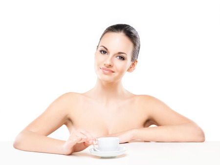helthcare: Portrait of young, beautiful and healthy woman drinking morning coffee isolated on white Stock Photo