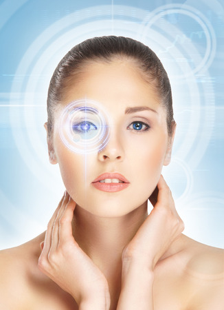 Young and attractive woman from future with the laser hologram on her eyes (eye scanning technology, optometry and virtual reality concept)