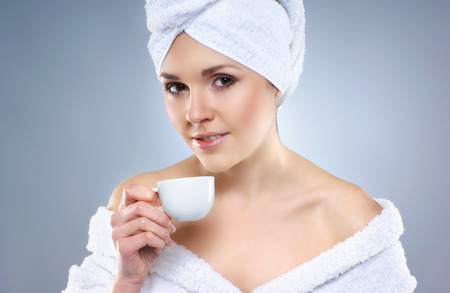 helthcare: Young attractive woman in towel drinks coffee