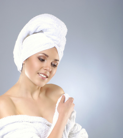 helthcare: Young attractive woman in towel making the spa treatment