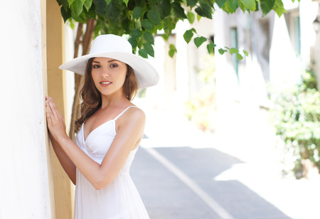 beautiful brunette: Young and beautiful lady walking down the ancient street