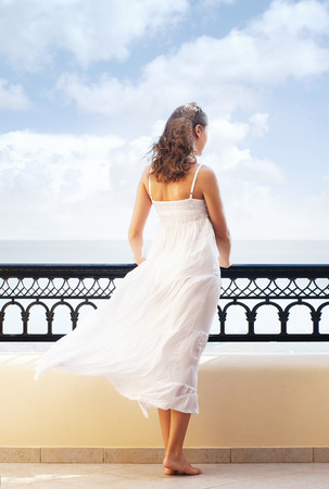Young attractive woman on the balcony