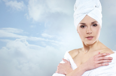 helthcare: Young, beautiful and healthy young woman in bath clothes over sky background Stock Photo