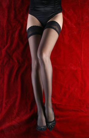 sexy legs: sexy legs on red Stock Photo