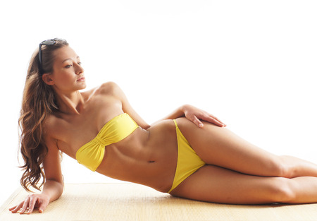 junge nackte m�dchen: Stock photo of young, fit and sexy woman in yellow swimsuit