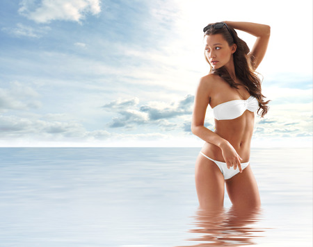 Young sexy brunette in swimsuit Stock Photo