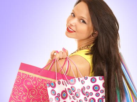 shopper: Attractive female shopper isolated on white