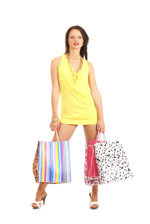 shopper: Young sexy shopper isolated over white background Stock Photo
