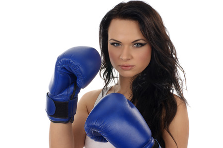 female boxing: Young beautiful sporty woman isolated on white