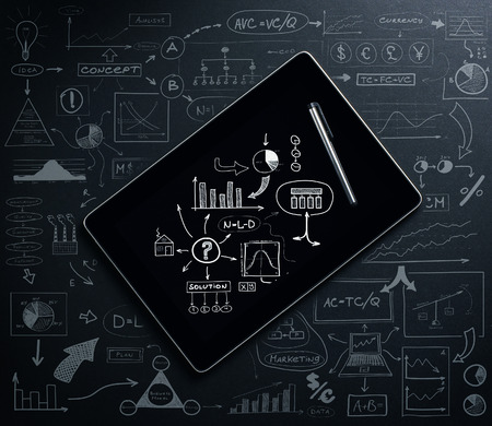 graph theory: A tablet computer with a business plan concept drawing around Stock Photo