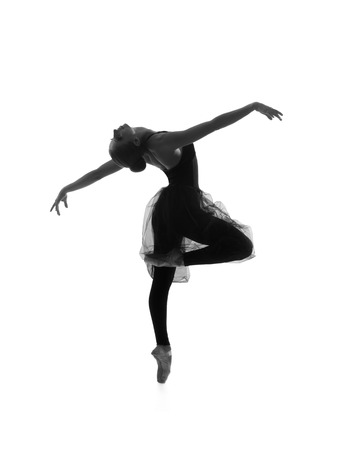 Black and white trace of young beautiful ballet dancer isolated over white background 스톡 콘텐츠