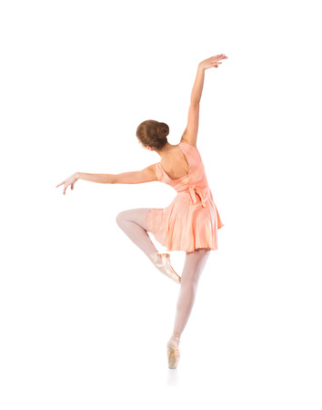 sexual position: Young beautiful ballet dancer isolated over white background Stock Photo