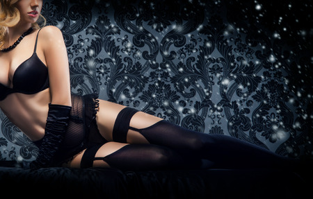 sexy boobs: Young sexy woman in erotic lingerie over snowy Christmas background