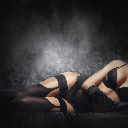 erotic women: Erotic photo of young and beautiful woman in sexy underwear over smoky background