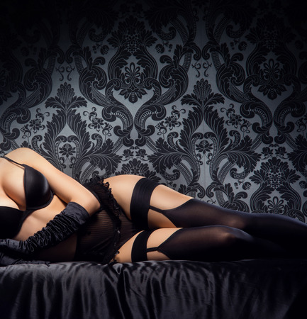 Sexy body of young and beautiful woman in lingerie over vintage background