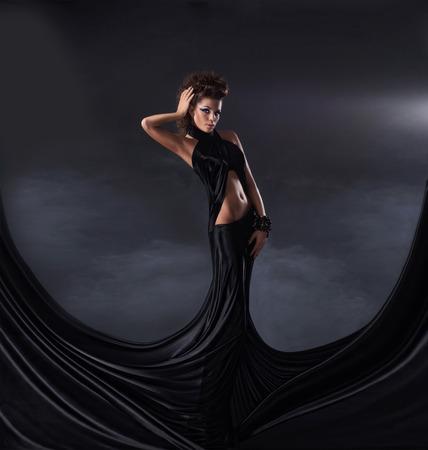 satanist: Sexy woman in black dress