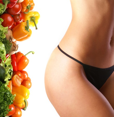 belly pepper: Belly of beautiful young female sportsman over dieting background