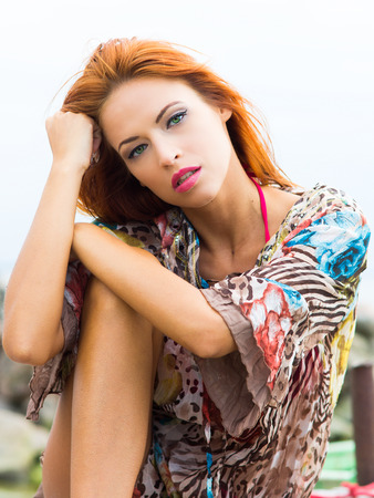 beautiful redhead: Portrait of young and beautiful redhead woman Stock Photo