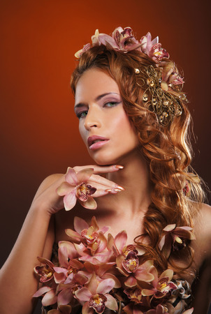 Young attractive woman with the haircut with flowers photo