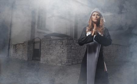 religious habit: Fashion shoot of young nun Stock Photo