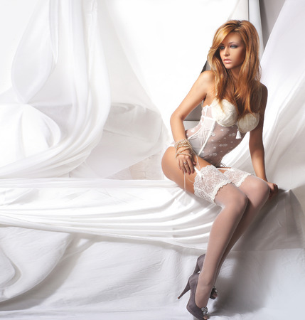 silk bra: Young and sexy redhead woman in white lingerie Stock Photo