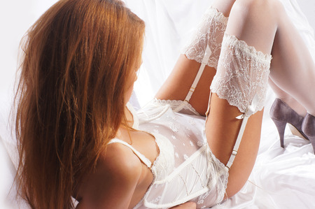 redhead: Fashion image of young and sexy redhead woman in white lingerie Stock Photo