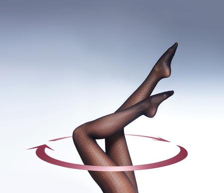 pantimedias: Hermosas piernas femeninas en pantimedias aislados en blanco Foto de archivo