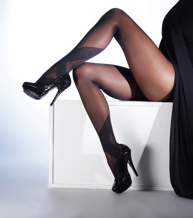 photo of the beautiful legs in nice stockings photo
