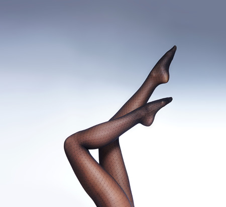 Beautiful female legs in pantyhose isolated on white photo