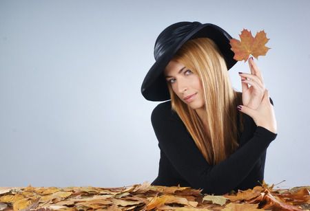 widow: Attractive widow in autumn concept over grey background Stock Photo