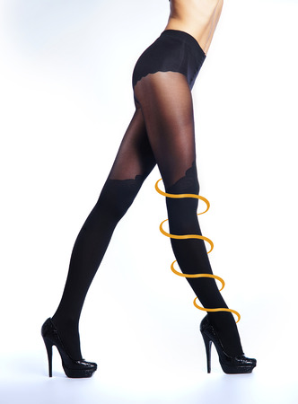 hosiery: Female legs in pantyhose over white background. Health care and healthy hosiery concept.