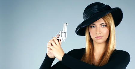 widow: Young attractive killer widow over grey background