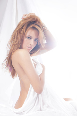 nu: Fashion image of young and sexy redhead woman in white lingerie Stock Photo