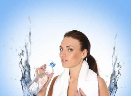 cheekbones: Young attractive female sportsman drinking water isolated on white