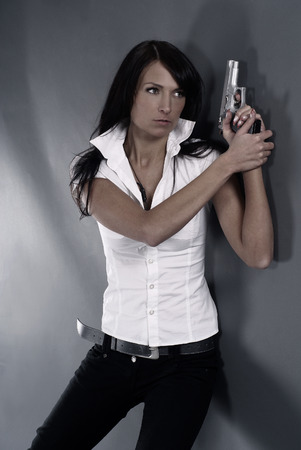 fbi: Sexy woman with weapon
