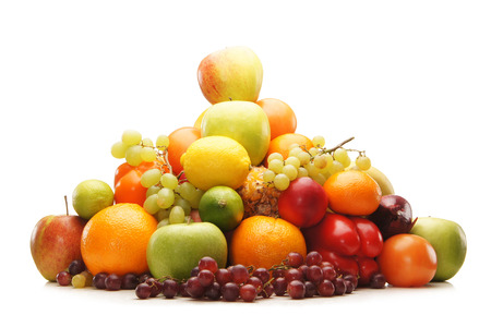Pile of fresh and tasty fruits and vegetables isolated on white photo