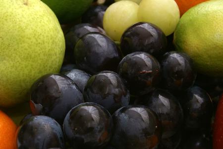 uva: Set of uva and different fresh tasty fruits Stock Photo