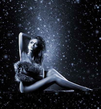 sexy fur: Sexy girl in underwear over the Christmas background with a snowflakes Stock Photo