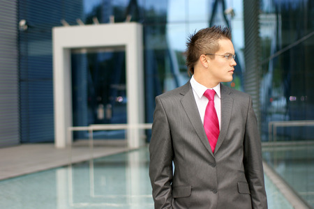 young businessman over modern background photo