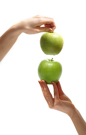womans hands: Tasty sweet apples in graceful womans hands Stock Photo