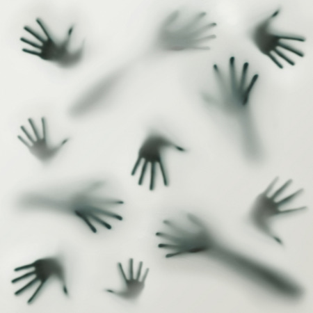 Frightening silhouette of many different hands Stock Photo